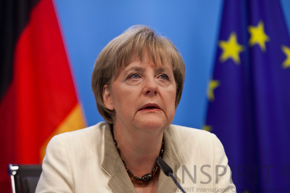 German Chancellor Angela Merkel speaks during a media conference after an EU summit of eurogroup members at the EU Council building in Brussels on Thursday, July 21, 2011. PHOTO: ERIK LUNTANG / INSPIRIT Photo.