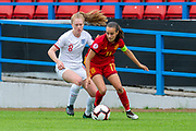 Rosa Marquez (#17) of Spain shields the ball from Amy Rodgers (#8) of England during the UEFA Women's U19 European Championship match between England Women and Spain at Forthbank Stadium, Stirling, Scotland on 19 July 2019.