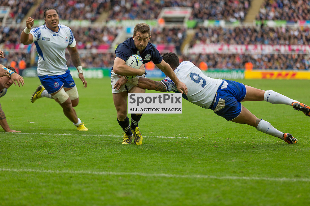 Scotland #9 Greig Laidlaw on his way to a second half try.  Scotland v Samoa, 10th October 2015
