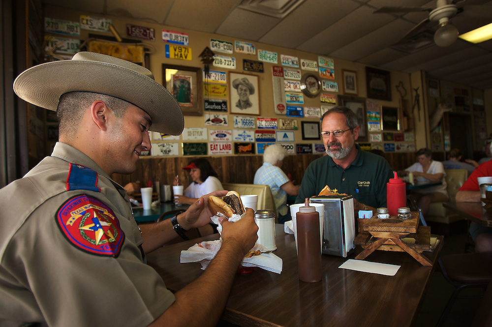 Texas State Trooper Freddie Hatch (cq) left, enjoys a sandwich along with Jerry White at  the Packsaddle Bar-b-que as people in the San Angelo area spend the day relaxing, shopping, recreating and eating as the whole FLDS saga goes on around them, most are keenly aware of the story, but just are going about their business hoping the story comes to some sort of positive conclusion. Photo taken on Saturday May 31, 2008. August MIller/ Deseret News .