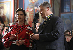 April 27, 2019 - Kiev, Ukraine - Ukraine's incumbent President Petro Poroshenko, on right,  with his wife Maryna while participating in the Easter service at St. Michael's Cathedral in Kiev. Ukraine, Saturday, April 27, 2019. (Credit Image: © Danil Shamkin/NurPhoto via ZUMA Press)