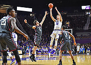 MANHATTAN, KS - MARCH 09:  Dean Wade #32 of the Kansas State Wildcats puts up a shot against Matt Freeman #5 of the Oklahoma Sooners during the second half on March 9, 2019 at Bramlage Coliseum in Manhattan, Kansas.  (Photo by Peter G. Aiken/Getty Images) *** Local Caption *** Dean Wade;Matt Freeman