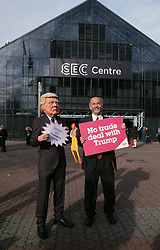 Pictured: Stewart Rolfe (as Donald Trump) and Bob Gillespie from Genetic Justice Glasgow wanted conference to hear their views<br /> The members of the SNP gathered in the Scottish Events Campus in Glasgow for their annual conference.<br /> <br /> The Ger Harley | EEm 9 October 2017