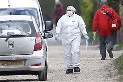 © Licensed to London News Pictures. 31/03/2020. Woodmancote, UK. Police forensics officers are seen outside a house in Duffield Lane in the village of Woodmancote near Chichester, West Sussex where the bodies of a family of four were found on Sunday. Police have started a murder investigation after they found the bodies and a dead dog after responding to a report of concern for the occupants of the house on Sunday evening. Photo credit: Peter Macdiarmid/LNP