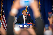 NORTH AUGUSTA, S.C. _ FEBRUARY 16, 2016: Presidential candidate Donald Trump takes the stage as his to supporters wave signs and cheer during a campaign stop, Tuesday, Feb. 16, 2016 in North Augusta, S.C.  CREDIT: Stephen Morton for The New York Times