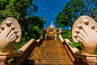 Naga sculptures and staircase to Wat Phnom is a sacred Buddhist pagoda prominently sitting atop a small hill  (at 89 feet it is the highest point in the city) in the Cambodian capital city of Phnom Penh. It was built in 1373.