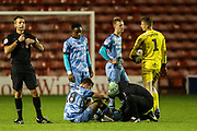 Forest Green Rovers Kevin Dawson(18) goes down injured and is treated by Forest Green Rovers physio Joe Baker during the EFL Trophy match between Walsall and Forest Green Rovers at the Banks's Stadium, Walsall, England on 12 November 2019.