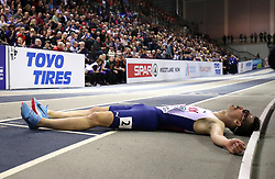 Norway's Henrik Ingebrigtsen lays on the flour after his bronze win during the Men's 3000m final during day two of the European Indoor Athletics Championships at the Emirates Arena, Glasgow.