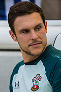Cedric Soares (Southampton) on the bench after warming up before the Premier League match between Brighton and Hove Albion and Southampton at the American Express Community Stadium, Brighton and Hove, England on 24 August 2019.