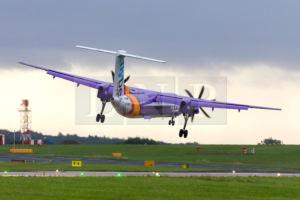 © Licensed to London News Pictures. 18/09/2018. Leeds UK. A Flybe aircraft struggles to land this morning in strong cross winds at Englands highest airport, Leeds Bradford International. Wind speeds are expected to increase tomorrow with the arrival of Storm Ali. Photo credit: Andrew McCaren/LNP
