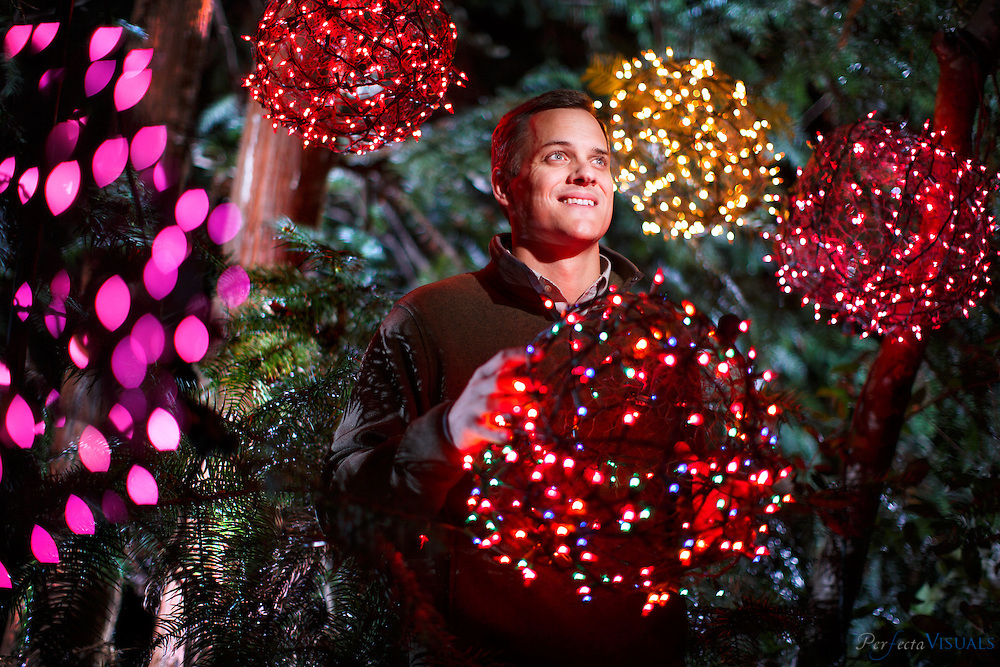 Justin Smith with some of his &quot;tree ball&quot; creations he and his family are known for on Tuesday, November 10, 2015, in Greensboro, N.C.<br /> <br /> JERRY WOLFORD and SCOTT MUTHERSBAUGH / Perfecta Visuals<br /> <br /> A teenage Justin Smith grinned with excitement as he launched the lighted Christmas balls his family crafted of chicken wire and colorful holiday lights high into the trees in his yard with his homemade potato gun.<br />  <br /> Over the next nineteen years, Justin helped his family&rsquo;s DIY project evolve into a community endeavor that would provide close to one million meals for the hungry.<br />  <br /> He praises his parents for showing him how to simultaneously help others, have fun and work hard.<br />  <br /> &ldquo;I have been able to see that this way of living is commonplace.&rdquo;<br />  <br /> As a financial planner, he helps people with their money.  <br />  <br /> As a mentor for youth leaders, he guides young males as they lead their communities.<br />  <br /> As a board member for Crescent Rotary, he lends a hand to people in need.<br />  <br /> Justin aims to raise his three children with the same sense of community that he was raised with.<br />  <br /> &ldquo;My hope is that my family and I create this environment of being selfless and being passionate for somebody else and my kids get to combine fun and community with doing something bigger.&rdquo;