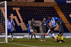 Rotherham's Adam Collin   misses a catch and collides with his own player Referee Mr B Malone signals a foul and disallows the resulting goal from Colchester's Sanchez Watt  - Photo mandatory by-line: Mitchell Gunn/JMP - Tel: Mobile: 07966 386802 04/03/2014 - SPORT - FOOTBALL - Colchester Community Stadium - Colchester - Colchester v Rotherham - Sky Bet League 1