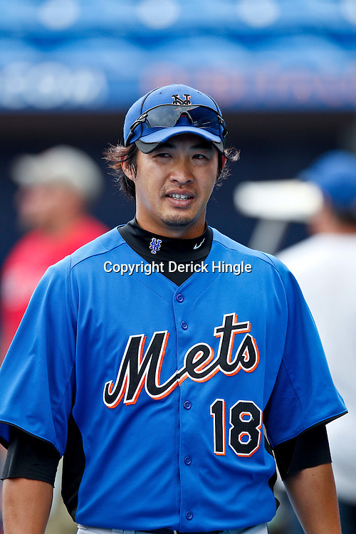 March 6, 2011; Port St. Lucie, FL, USA; New York Mets relief pitcher Ryota Igarashi (18) before a spring training exhibition game against the Atlanta Braves at Digital Domain Park.  Mandatory Credit: Derick E. Hingle