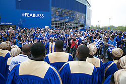 © Licensed to London News Pictures. 07/05/2016. Leicester, UK. Leicester City fans celebrating outside the King Power stadium before their match with Everton before lifting the Premiership trophy. Pictured, a gospel choir add to the festival atmosphere. Photo credit: Dave Warren/LNP