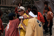 Young men drinking prior to the start of the main event at the Tado Horse Festival.