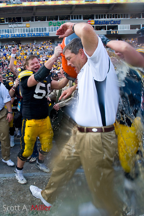 Jan 1, 2009; Tampa, FL, USA; Iowa Hawkeyes coach Kirk Ferentz is showered with water after his team by the South Carolina Gamecocks 31-10 in the Outback Bowl at the Raymond James Stadium. Iowa won the game 31-10. ©2009 Scott A. Miller