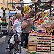 Woman shopping for food at market in Piazza delle Erbe, Padua Italy