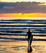 Surfer Silhouette Against Layers of Waves at Sunrise, Cocoa Beach, Florida