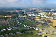 Nederland, Noord-Brabant, Eindhoven, 24-10-2013; Knooppunt Batadorp, A58 richting Tilburg, A2 in de voorgrond. Bedrijventerrein Breeven. <br /> Ringroad Eindhoven, Batadorp Junction<br /> luchtfoto (toeslag op standaard tarieven);<br /> aerial photo (additional fee required);<br /> copyright foto/photo Siebe Swart.