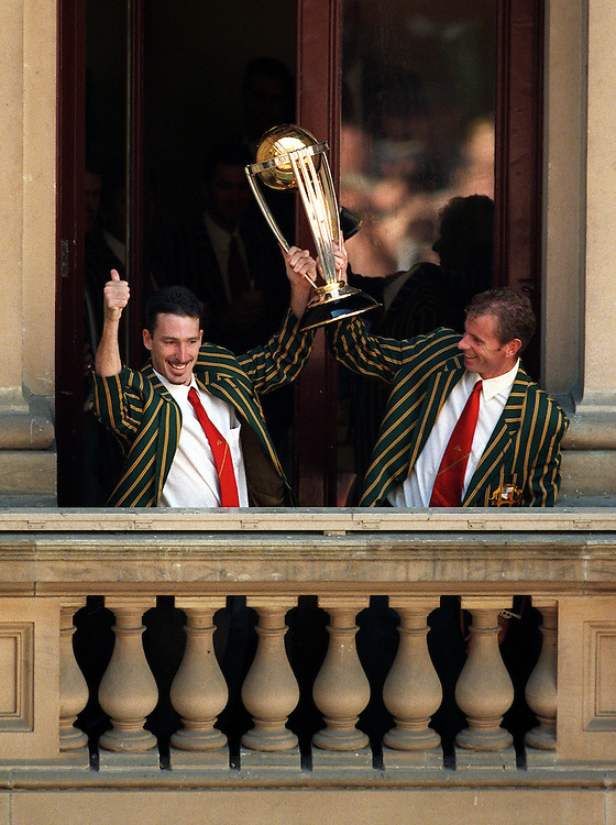 csz990623.002.004.jpg.melb.pic craig sillitoe.gen..damien fleming and paul rifle hold the trophy high at the town hall swanston st.***FDCTRANSFER*** melbourne photographers, commercial photographers, industrial photographers, corporate photographer, architectural photographers, This photograph can be used for non commercial uses with attribution. Credit: Craig Sillitoe Photography / http://www.csillitoe.com<br />