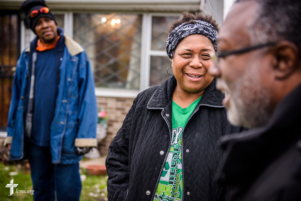 The Rev. Delwyn Campbell, national missionary to Gary, Ind., witnesses with Melody Jefferson and Anthony King at a home in Gary on Wednesday, April 5, 2017. LCMS Communications/Erik M. Lunsford
