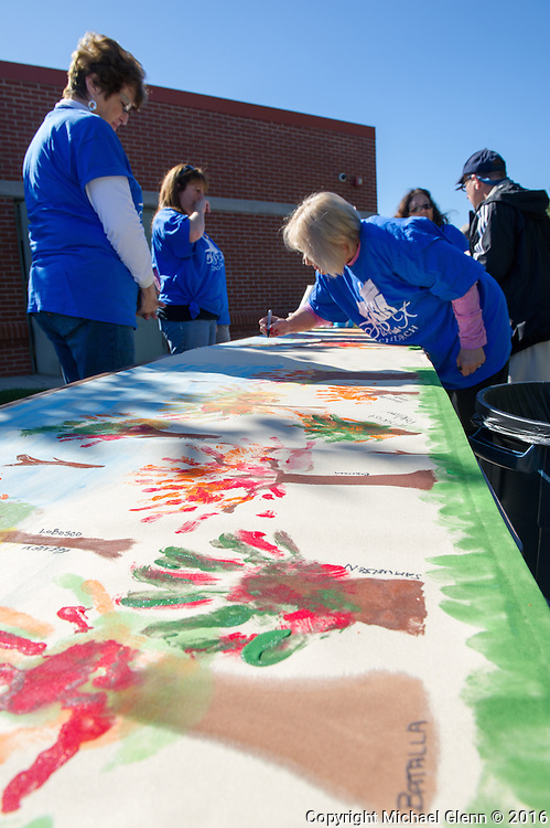 15 Oct. 2016 Forked River USA / Vistors write their family members names on their Family tree made with paint from their hands pressed onto the fabric. St Pius X celebrates it's 10th year in their new church with a festival open to all  /  Michael Glenn  / Glenn Images