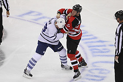 Nov 2; Newark, NJ, USA; Toronto Maple Leafs defenseman Mike Komisarek (8) and New Jersey Devils center Brad Mills (11) fight during the first period at the Prudential Center.