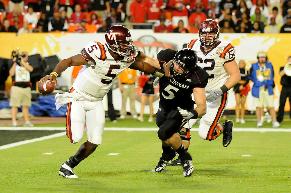 January 1, 2009: Tyrod Taylor of the Virginia Tech Hokies eludes Connor Barwin of the Cincinnati Bearcats during the NCAA football game between the Virginia Tech Hokies and the Cincinnati Bearcats in the Orange Bowl Classic. The Hokies defeated the Bearcats 20-7.