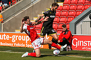 AFC Wimbledon defender Callum Kennedy (23) is tackled  during the EFL Sky Bet League 1 match between Fleetwood Town and AFC Wimbledon at the Highbury Stadium, Fleetwood, England on 19 August 2017. Photo by Simon Davies.