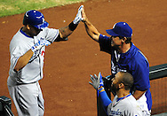 Jul. 15 2011; Phoenix, AZ, USA; Los Angeles Dodgers  batter Juan Rivera (33) is congratulated after hitting a solo home run during the second inning against the Arizona Diamondbacks at Chase Field. Mandatory Credit: Jennifer Stewart-US PRESSWIRE..