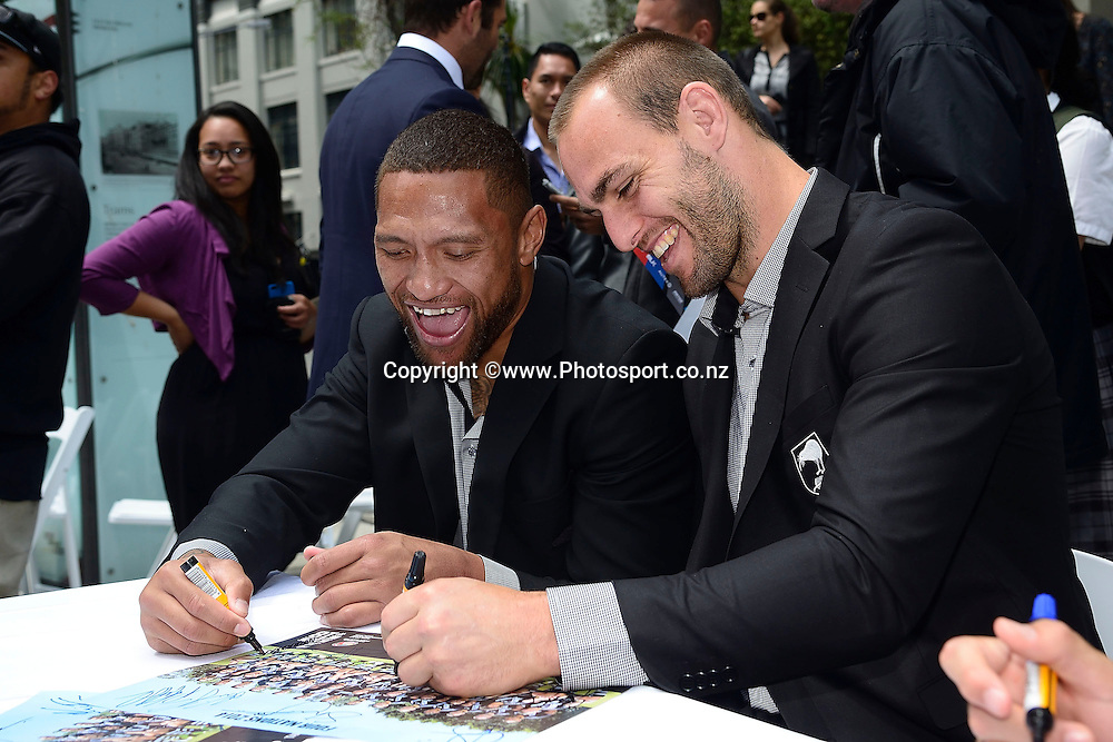 Kiwi's captain Simon Mannering (R and team mate Manu Vatuvei sign autographs during the Four Nations Kiwis and Kangaroos Civic Reception at Midland Park in Wellington on Wednesday the 12th of November 2014. Photo by Marty Melville/www.Photosport.co.nz