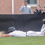 Caravel Academy Bradley Kaden (3) slides head first into third base in the mist of the second round of the DIAA baseball state tournament between#4 Caravel Academy and #15 St. Elizabeth Saturday May 27, 2017, at Caravel Academy in Bear Delaware.