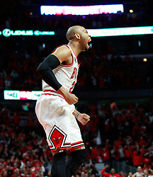 15.05.2011, UNITED CENTER, CHICAGO, USA, NBA, Chicago Bulls vs Miami Heat, im Bild Taj Gibson reacts after scoring against Miami Heat in game 1 of the NBA Eastern Conference Championships at the United Center in Chicago, EXPA Pictures © 2011, PhotoCredit: EXPA/ Newspix/ KAMIL KRZACZYNSKI +++++ ATTENTION - FOR AUSTRIA/ AUT, SLOVENIA/ SLO, SERBIA/ SRB an CROATIA/ CRO, SWISS/ SUI and SWEDEN/ SWE CLIENT ONLY +++++