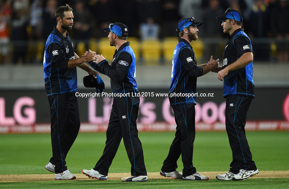 Grant Elliott, Brendon McCullum, Kane Williamson and Corey Anderson shake hands at the end of the ICC Cricket World Cup quarter final match between New Zealand Black Caps and the West Indies, Wellington, New Zealand. Saturday 21March 2015. Copyright Photo: Andrew Cornaga / www.Photosport.co.nz