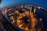 Downtown Saigon at dusk. Me Linh Square and Saigon River, seen from Renaissance Riverside Hotel.