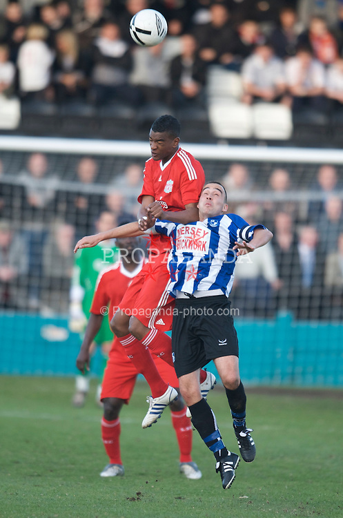 LIVERPOOL, ENGLAND - Monday, April 27, 2009: Liverpool's Damien Plessis and Waterloo Dock's captain Anthony Battle during the Liverpool Senior Cup Final at the Arriva Stadium. (Photo by David Rawcliffe/Propaganda)