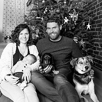 Black & white St. Louis lifestyle family photography in front of a Christmas tree.