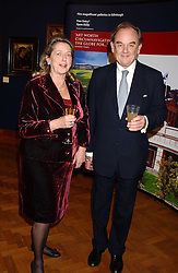 MR ADRIAN & the HON.MRS WHITE at a reception hosted by Brian Ivory Chairman of the Trustees of The National Galleries of Scotland to commemorate Sir Timothy Clifford's 21 years of Director of the National Gallery of Scotland and his forthcoming retirement in January 2006, held at Christie's, King Street, London W1 on 6th December 2005.<br />