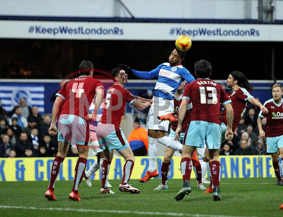 Matt Phillips of Queens Park Rangers heads the ball - Mandatory byline: Robbie Stephenson/JMP - 12/12/2015 - Football - Loftus Road - London, England - Queens Park Rangers v Burnley  - Sky Bet Championship