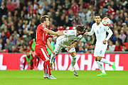 England's Gary Cahill heads clear  during the UEFA European 2016 Qualifying match between England and Switzerland at Wembley Stadium, London, England on 8 September 2015. Photo by Shane Healey.