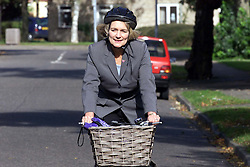 Anne Campbell, MP for Cambridge, is looking busy as she cycles around in Cambridge meeting members of the public and finding out about their problems. October 8, 2000..Photo by Andrew Parsons/i-Images..