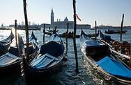 Gondolas on the Venice Lagoon on a winter morning;  Venice, Italy