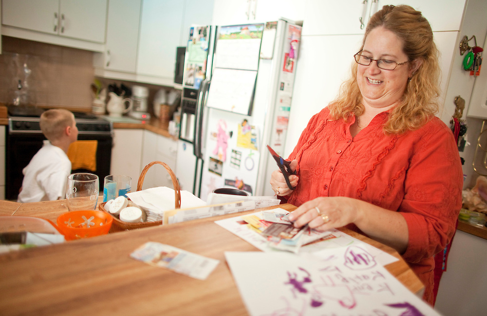 London, Ontario ---11-05-30--- Kim Thornton, a mother of 4 children clips coupons in her London, Ontario home May 30, 2011, as her family finds ways to save money to pay off more than $50,000 of consumer debt they have accumulated.<br /> GEOFF ROBINS The Globe and Mail