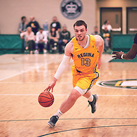 2nd year forward, Carter Millar (13) of the Regina Cougars during the Men's Basketball Home Game on Fri Feb 01 at Centre for Kinesiology,Health and Sport. Credit: Arthur Ward/Arthur Images