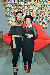 Left to right, LEAH WELLER and LULU GUINNESS at the launch of The Lulu Perspective to celebrate 25 years of Lulu Guinness held at 74a Newman Street, London on 13th September 2014.