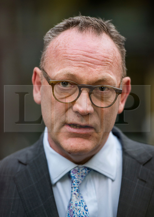 "©  London News Pictures. 28/01/2016. London, UK. BEN EMMERSON QC, lawyer to marina Litvinenko speaking to the media following private talks with British home secretary Theresa May. The meeting comes a week after an official inquiry into her husband's death concluded that his killing was ""probably approved"" by Russian president Vladimir Putin. Photo credit: Ben Cawthra/LNP"