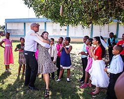 Dancing Classrooms Global Program Director Rodney Lopez, and Dancing Classrooms VI Executive Director Katie Zaytoun dance together for their students after the Claude O. Markoe Elementary School Dancing Classrooms VI Culminating Event.  17 December 2015.  Christiansted, St. Croix.   © Aisha-Zakiya Boyd.