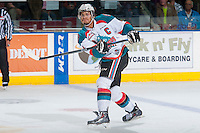 KELOWNA, CANADA - MAY 13: Madison Bowey #4 of Kelowna Rockets makes a pass against the Brandon Wheat Kings on May 13, 2015 during game 4 of the WHL final series at Prospera Place in Kelowna, British Columbia, Canada.  (Photo by Marissa Baecker/Shoot the Breeze)  *** Local Caption *** Madison Bowey;