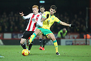 Norwich City striker Nelson Oliveira (9) battles for ball with Brentford midfielder Ryan Woods (15) during the EFL Sky Bet Championship match between Brentford and Norwich City at Griffin Park, London, England on 31 December 2016. Photo by Matthew Redman.