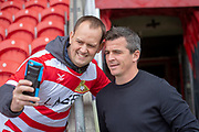 Fleetwood Town Manager Joey Barton stops for a selfie with a Doncaster Rovers fan prior to the EFL Sky Bet League 1 match between Doncaster Rovers and Fleetwood Town at the Keepmoat Stadium, Doncaster, England on 6 October 2018.